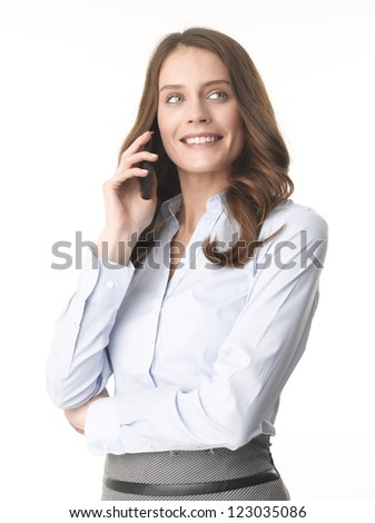 Happy young businesswoman using her mobile phone against isolated white background - stock photo