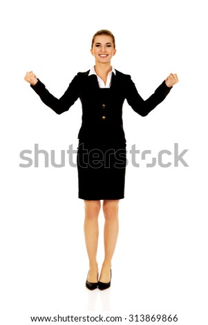 Happy young businesswoman.  Winning concept - stock photo