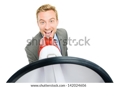 Happy young bussinessman shouting with megaphone on white background - stock photo