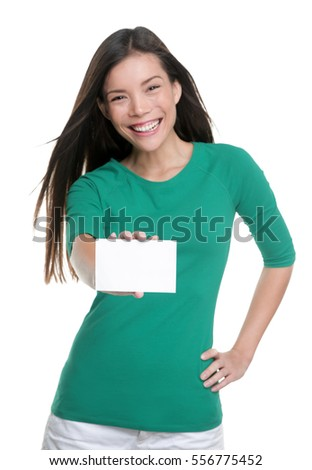 Happy young casual Asian woman holding blank sign showing business card for text advertisement.