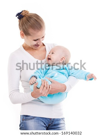 Happy young Caucasian woman and her baby son over white