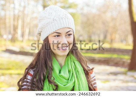 Happy Young Caucasian Woman Portrait outdoor. Autumn daylight cheerful lifestyle. - stock photo