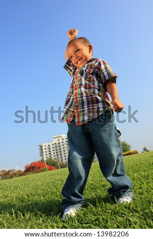 Happy Young Child on a Field - stock photo