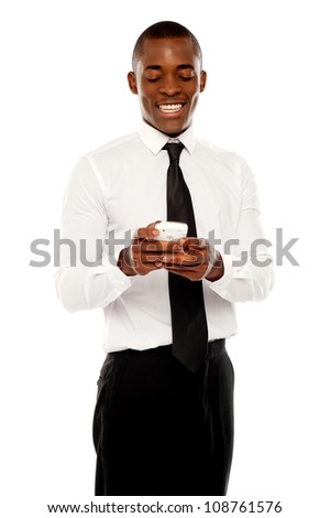 Happy young corporate man reading message on mobile isolated over white background