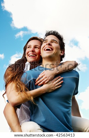Happy Young couple against the sky