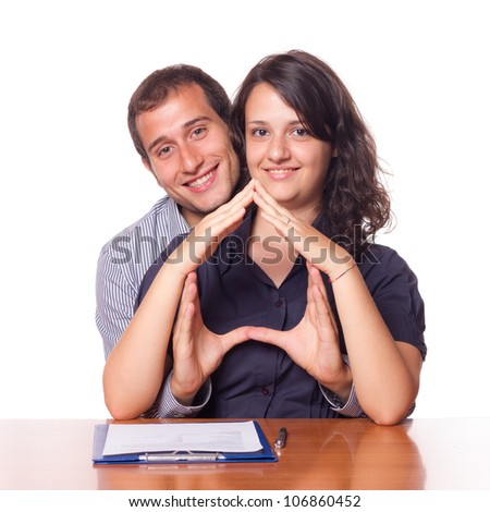 Happy Young Couple Buying an House - stock photo