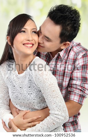 Happy young couple embracing, having fun together - stock photo