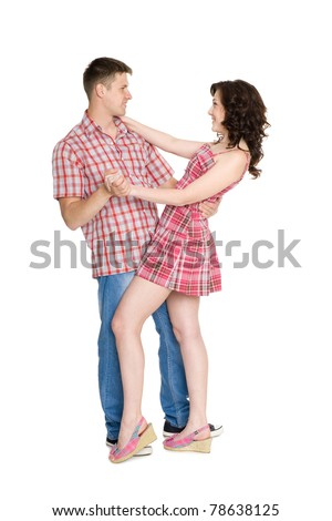 Happy young couple embracing. Isolated on white. - stock photo