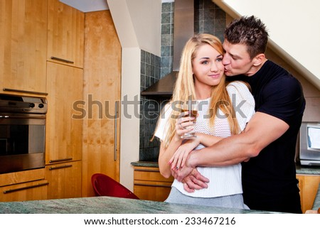 happy young couple have fun in kitchen. Drink coffee - stock photo