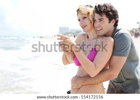 Happy young couple having fun at the beach