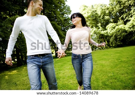 Happy young couple having great time together outdoors