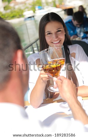 happy young couple having lanch at beautiful restaurant on by the sea on  beach - stock photo