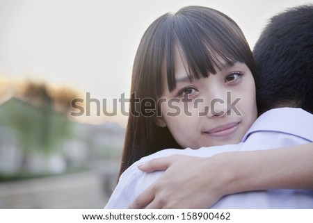 Happy young couple hugging - stock photo