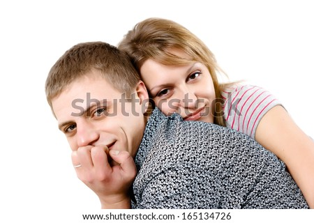 Happy young couple hugging on white background - stock photo