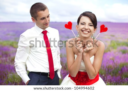 happy young couple in a lavender field. wedding day - stock photo