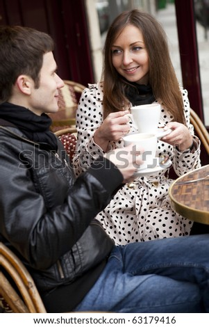 Happy young couple in a Parisian street cafe - stock photo