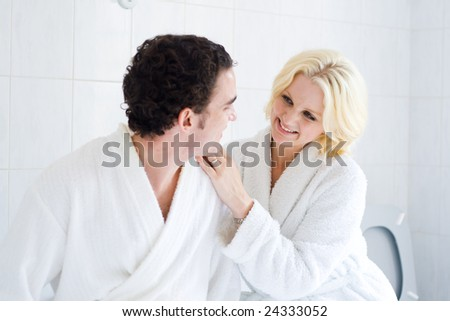 happy young couple in bathroom - stock photo