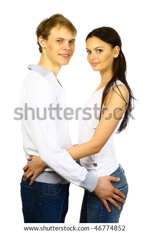 Happy young couple in casual clothing isolated over white background. - stock photo