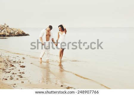Happy  young couple in love at seaside together.  - stock photo