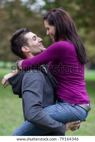 Happy young couple in love. In a park.