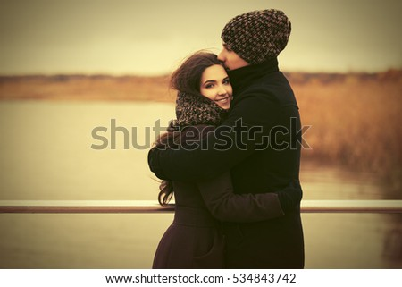 Happy young couple in love on the pier Stylish fashion model outdoor