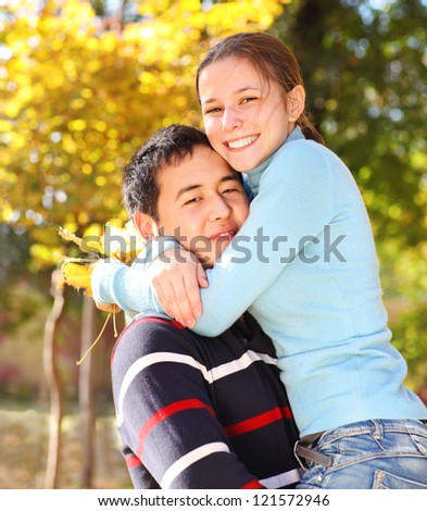 Happy young couple in love outdoors - stock photo