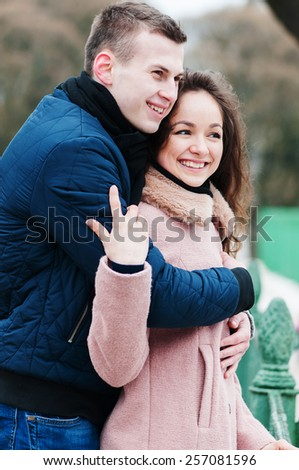 Happy young couple in love walking in the park, selective focus - stock photo