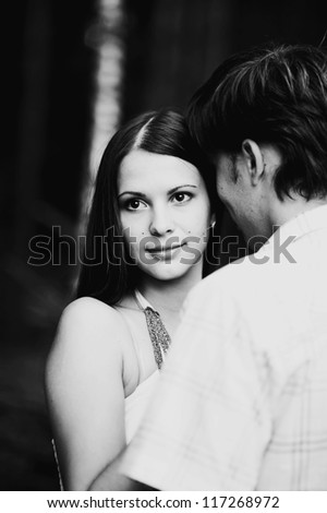 Happy young couple in park - stock photo