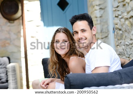 happy young couple in summer vacations holiday in the countryside