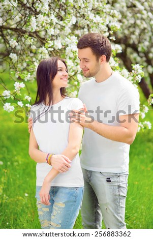 happy young couple in the garden - stock photo