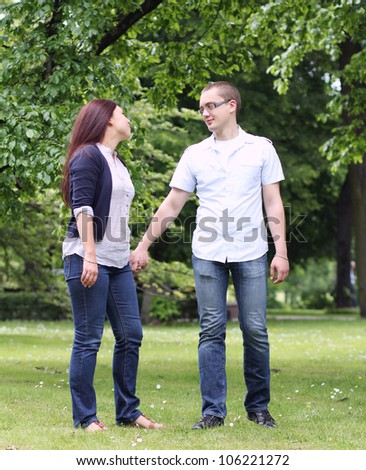 Happy young couple in the park