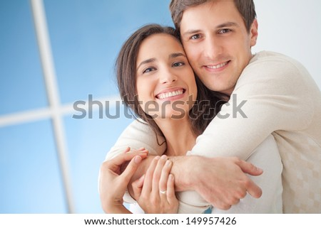 Happy young couple in their modern living room. - stock photo
