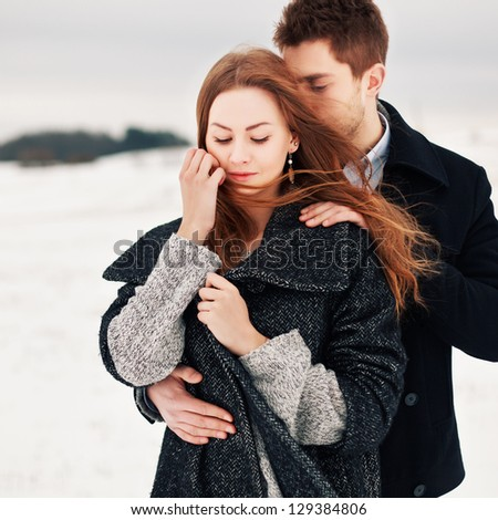 Happy Young Couple in Winter Park having fun.Family Outdoors. love - stock photo