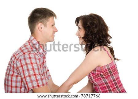 Happy young couple looking at each other. - stock photo