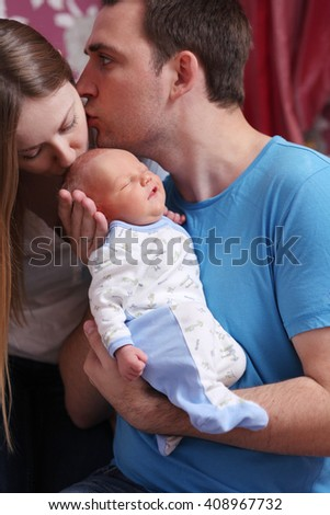 Happy young couple parent with baby boy - stock photo