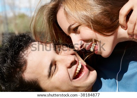 Happy young couple playing. close-up