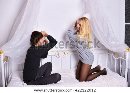 happy young couple relax and have fun in bed - stock photo