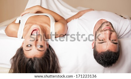 Happy young couple relaxing in a hotel room. - stock photo