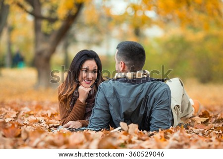 Happy young couple relaxing in nature - stock photo