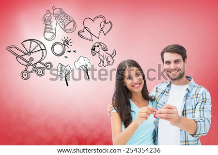Happy young couple showing new house key against red vignette - stock photo