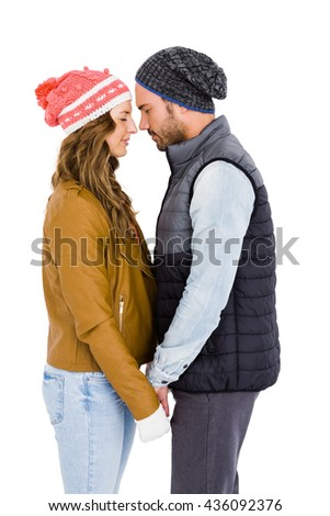 Happy young couple standing face to face on white background - stock photo