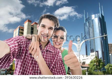 Happy, young couple take a self portrait photo, selfie, in Nairobi city, Kenya.Shallow doff - stock photo