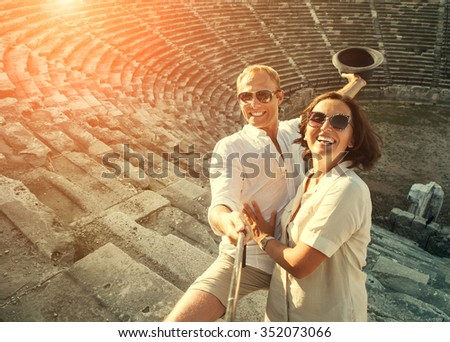 Happy young couple take self photo in their vacation - stock photo