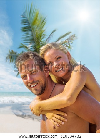 Happy Young couple together  by the  sea  - stock photo