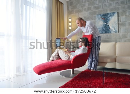 happy young  Couple Using Laptop computer At Home - stock photo
