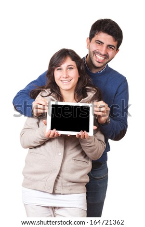 Happy Young Couple with Tablet PC - stock photo