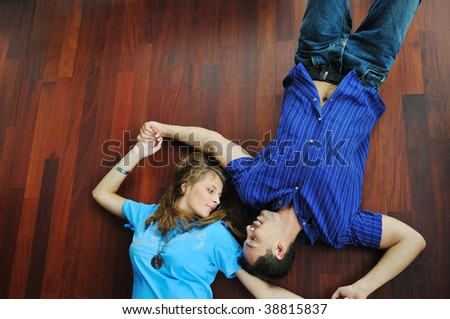 happy young cuple have fun and relax in their new big bright home apartment - stock photo