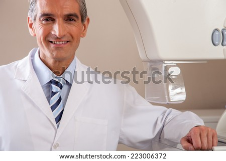 Happy young doctor showing confidence. - stock photo