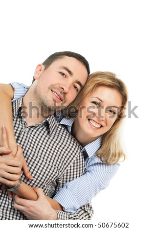 Happy young embracing couple; isolated on white background