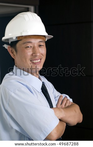 Happy young engineer, working in office - stock photo